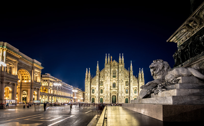 Il Duomo looked even more imposing by night, illuminated against the darkness in its stately square.