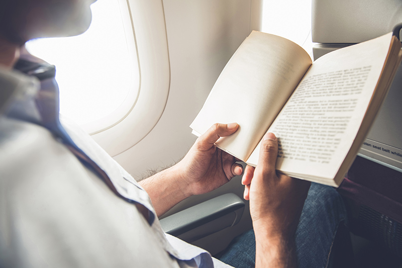 Reading is a great way to pass the time while travelling, especially if you have a long flight. You can get lost in a good book and the journey won't seem half as long.