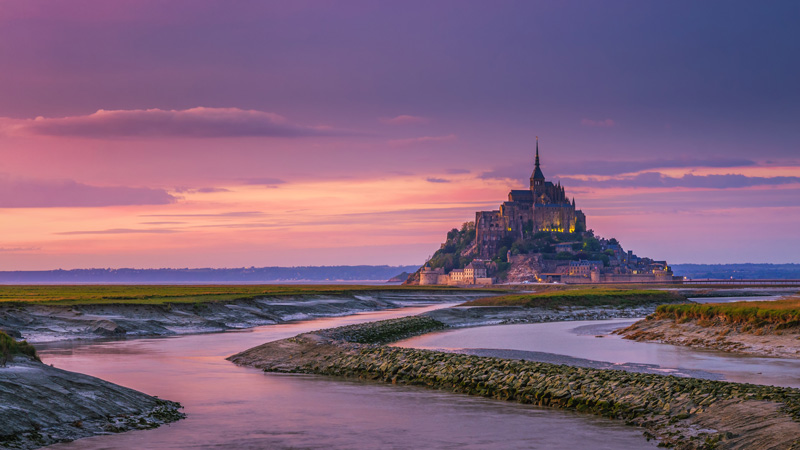 Le Mont-Saint-Michel is an island and mainland commune in Normandy, France and is a must-see attraction for those visiting the area.