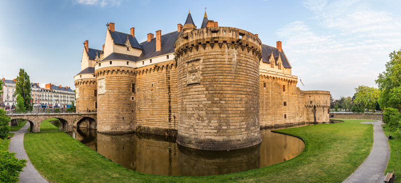Nantes is a port town with a medieval centre and a host of historic buildings to explore. The Château des Ducs de Bretagne makes for a beautiful place for a wander.