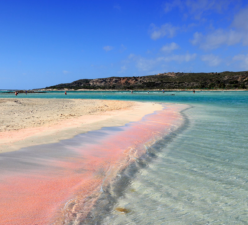 The sand on Elafonisi,Beach is pink as the coral has been broken down by the waves over time and washed up on the shore.