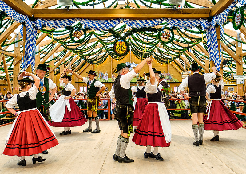 To really get into the spirit of Oktoberfest, many visitors and staff choose to wear traditional Bavarian clothing - lederhosen for the men, and for women, the dirndl - a corseted dress with a full skirt.