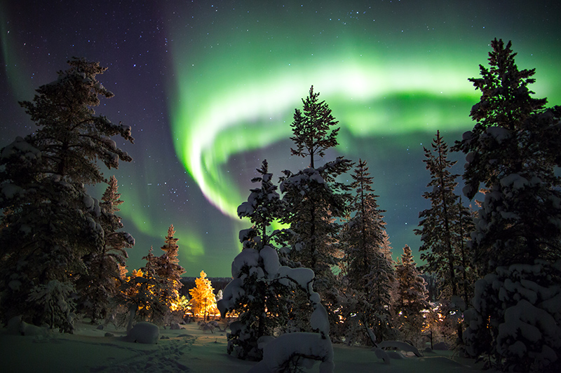 Snuggle up beneath a blanket and turn your gaze skywards to take in the glorious Aurora Borealis as it dances across the night sky.