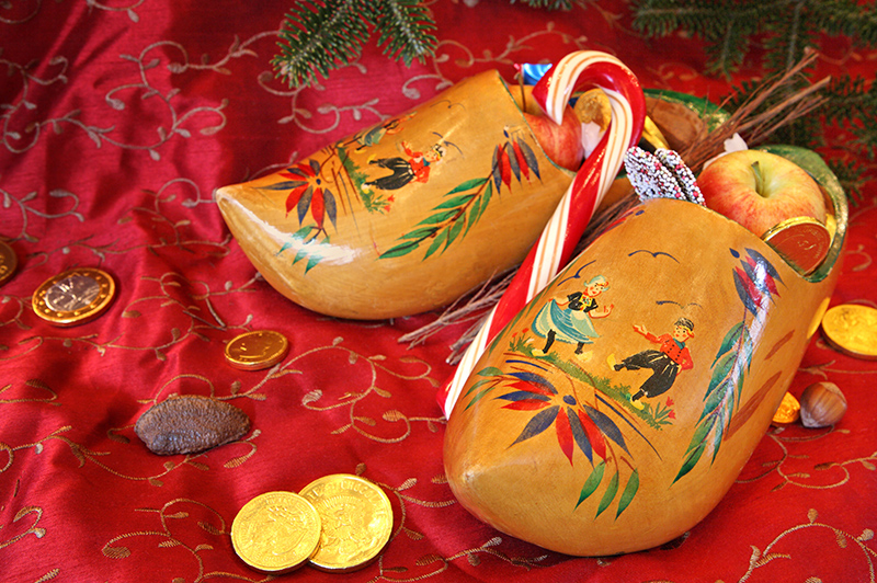 Children awake to find shoes stuffed with treats such as chocolate coins, candy canes and apples that have been gifted by Sinterklaas.