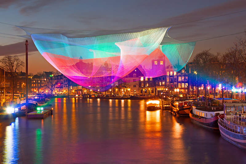 Marvel at millions of twinkling lights as they're reflected in the winding canals of Amsterdam, at the annual Amsterdam Light Festival.